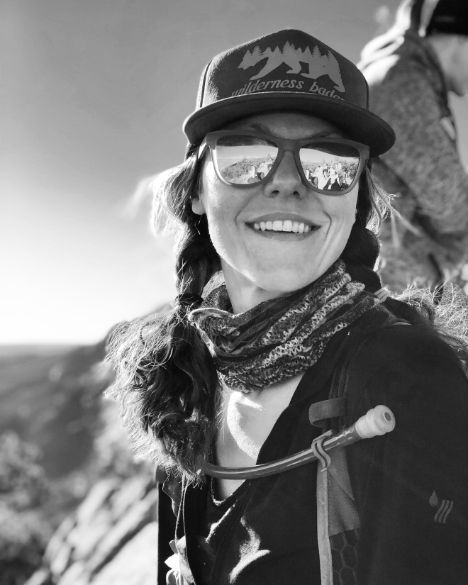 black and white, portrait, woman smiling, rei feature, mountains, summit, boulder, colorado, hiking, trailrunner