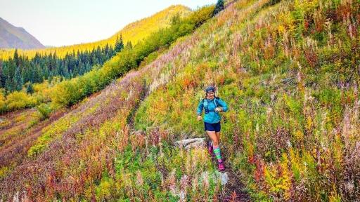 Running through fall colors during peak leaf weekend near Maroon Bells